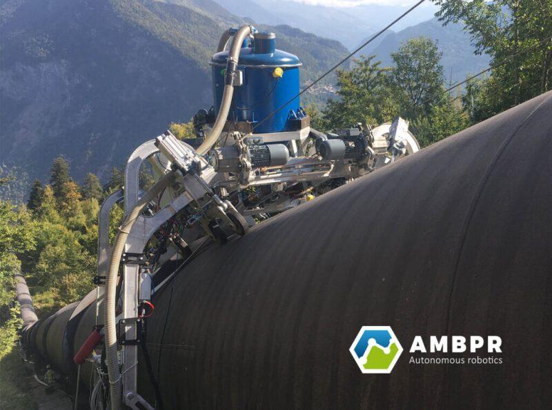 An AMBPR autonomous robot is shown painting a pipeline.