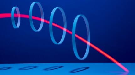 Red light streaking through 4 hoops