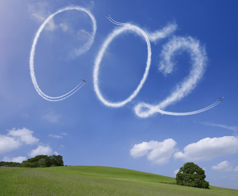 CO2 written in airstreams over a rural scene
