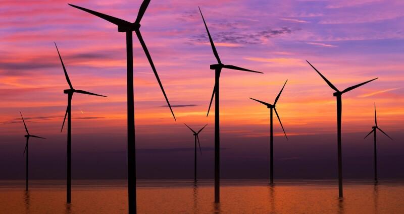 Wind turbine farm in beautiful nature landscape.