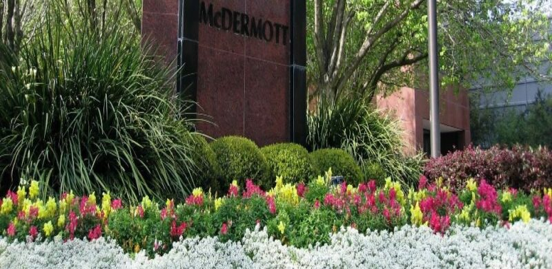 McDermott offices with flowerbeds in front