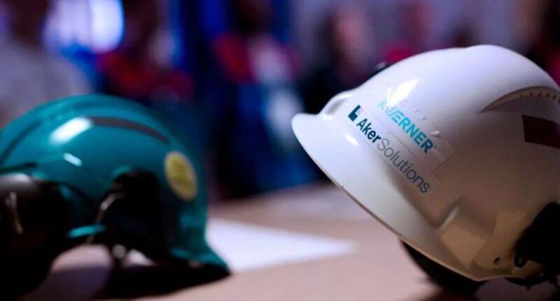 Hard hats showing both the Kvaerner and Aker Solutions logos