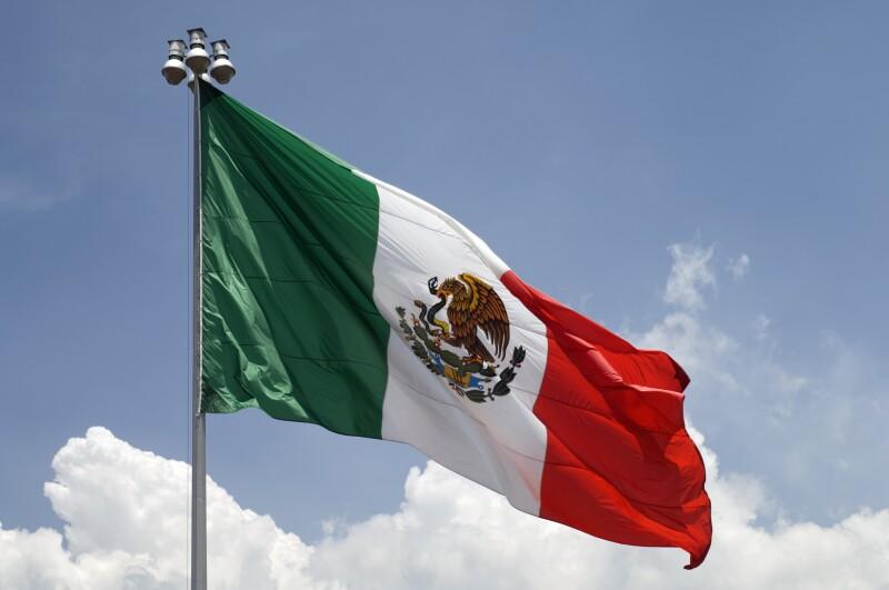 Flag of Mexico with blue sky