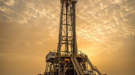 Oil drilling rig at dawn