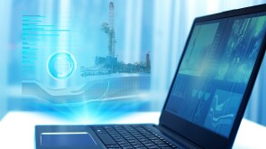 a hologram on a laptop, drilling a well to monitor and analyze geology in oil and gas production. Modern technology and artificial intelligence