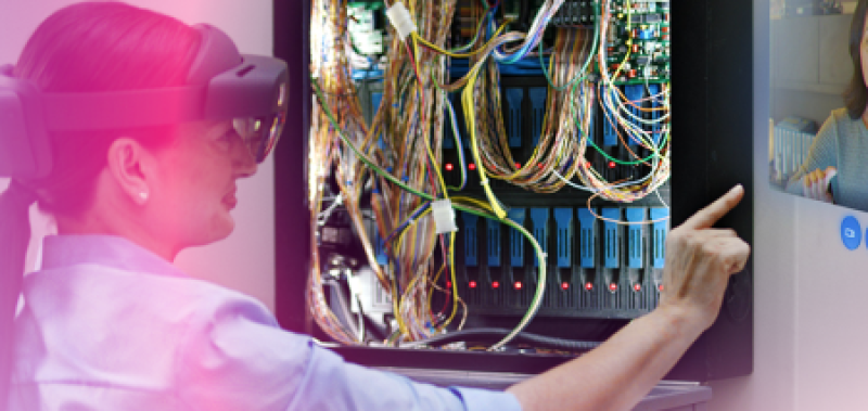 Female worker with AR goggles examines a maintenance panel