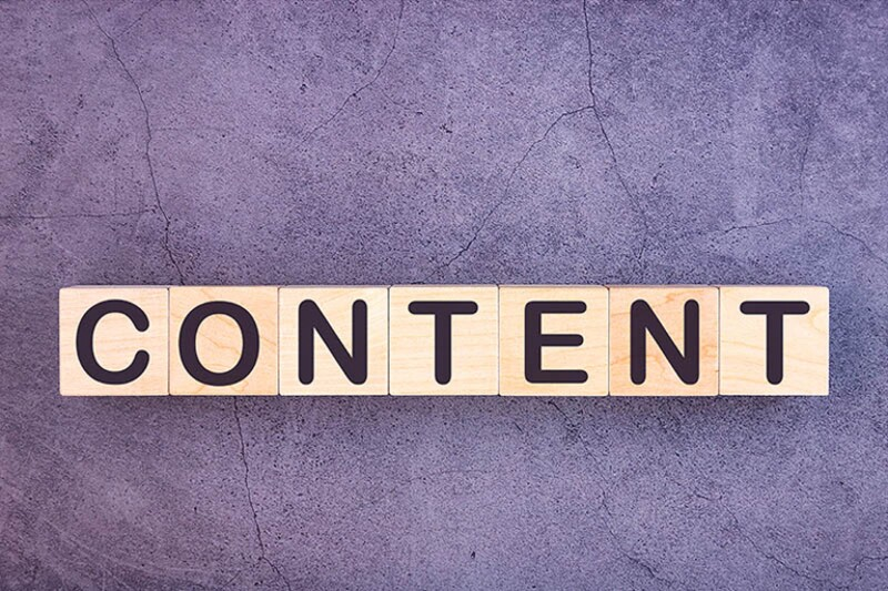 CONTENT word made with wood building blocks.