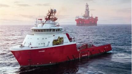 Ship by oil platform