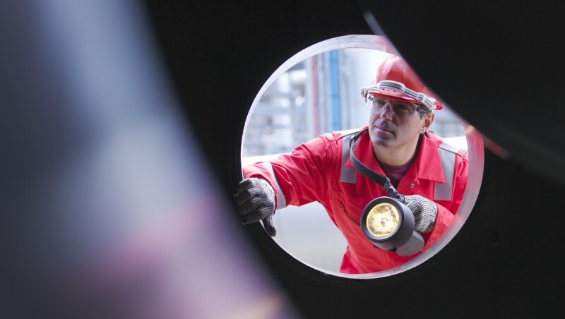 Worker inspects gas storage plant