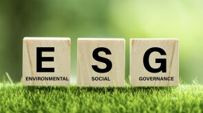 words ESG on a wood block and Future environmental conservation and sustainable ESG modernization development by using the technology of renewable resources to reduce pollution and carbon emission.
