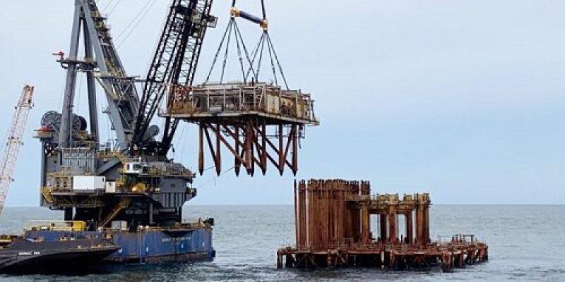 Heavy lift crane removing a portion of the platform