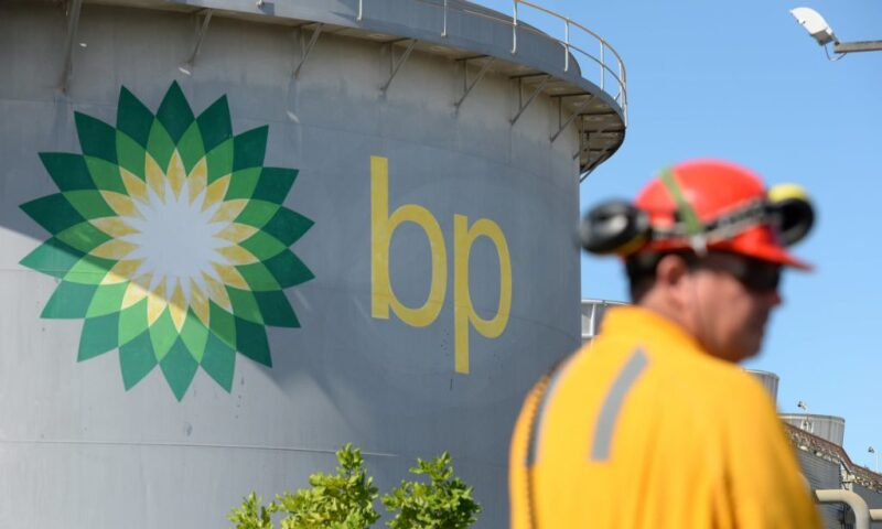 Worker near tank painted with BP logo