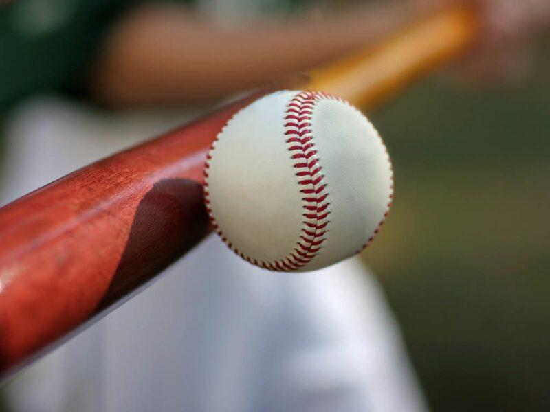 bat striking baseball