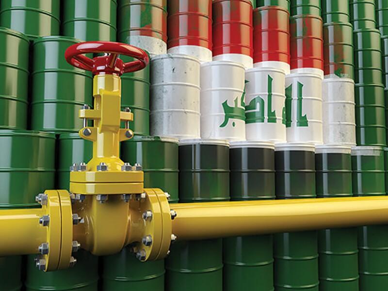 Barrels of oil behind a pipeline.