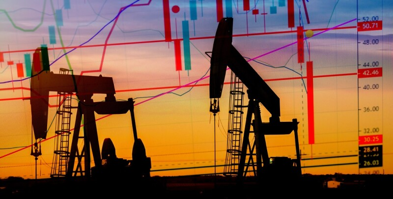 Illustration depicting the historic fall in the price of oil with an oil well in silhouette in the background