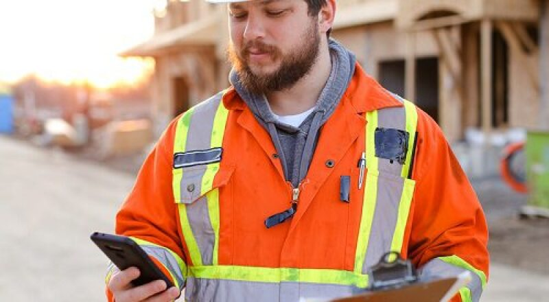 Worker looking at cell phone