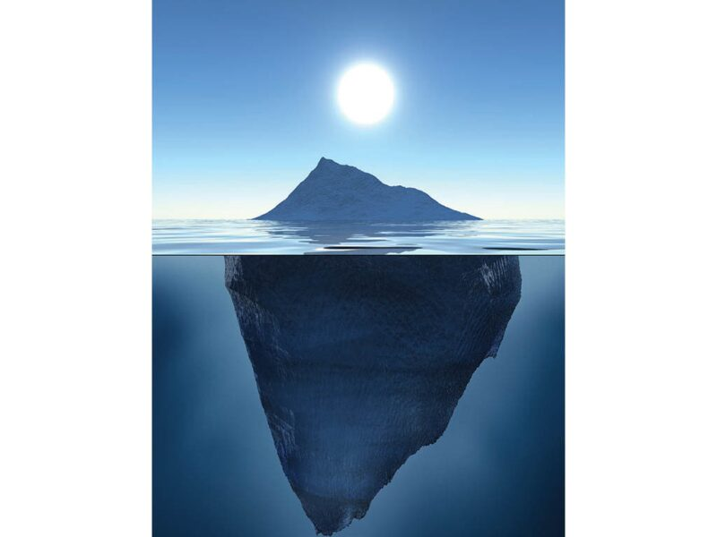 iceberg with most unseen below the water