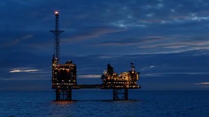 North Sea platform at night with active flare