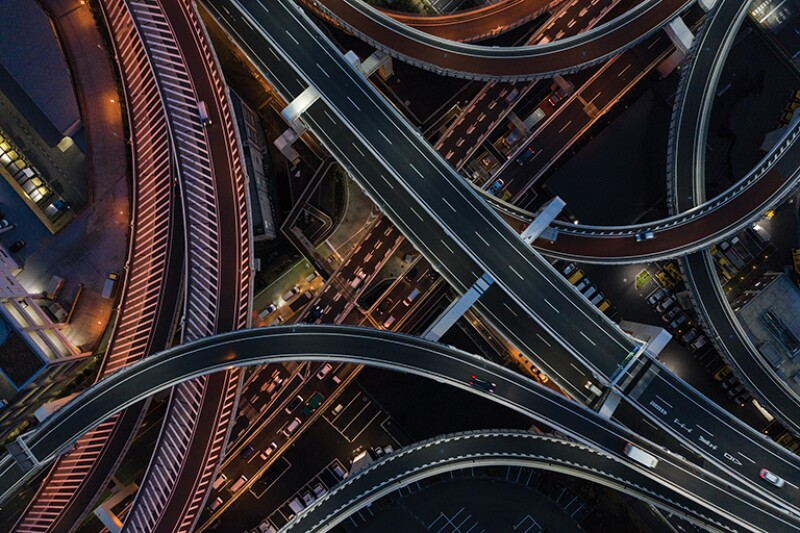Night photograph of complicated intersecting highway.