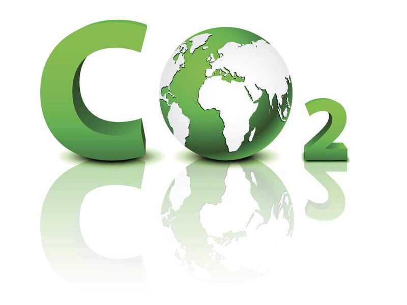 Letters CO2 where the O is represented by a globe