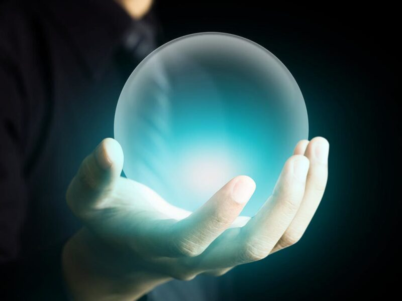 Glowing crystal ball in hand