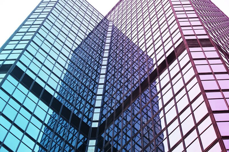 Two glass towers reflecting off each other
