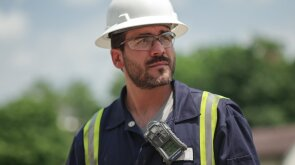 Worker wearing personal digital safety device.