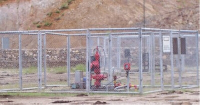 Wellhead with wire mesh protection.