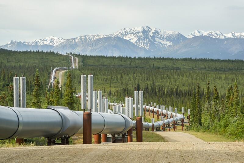 Pipeline winding in summer mountain landscape.