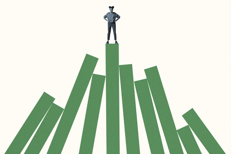 Woman standing on top of tall green bar graph